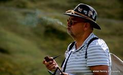 27-IMG_7018 Pipe Smoker (marinbiker 1961) Tags: baitapanoramahutte selvavalgardenadolomites italypipesmoker strippedtop outdoors mobilephone hat green highaltitude selvavalgardena italy italiandolomites
