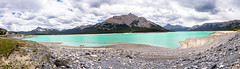 Panorama of Abraham Lake in low water level, July, Alberta, Canada (Vadim Gouida) Tags: alberta rockymountain abrahamlake canada landscape bluecolor water outdoor clouds summer forest mountain lake manmadelake gorge reservoir rockymountains seasonsky northamerica whitecloud