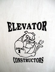 Yep. Bulldogs and stairs... (neppanen) Tags: usa dog newyork america logo manhattan elevator bulldog local koira constructors discounterintelligence sampen