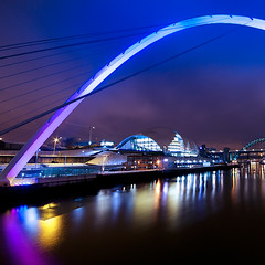 Millennium Bridge (Daisy Swain) Tags: longexposure england building water architecture night reflections river newcastle riverside arc sage millenniumbridge gateshead normanfoster northumberland walkway newcastleupontyne sigma1020mm canon60d