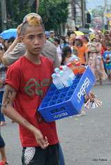 The waterboy (ubo_pakes) Tags: street city blue boy red portrait people man water nikon asia philippines cebu torso vendor procession tatoo cebucity crate seller visayas hawker d60 ubo pakes mygearandme sinulog2013 solemnparade