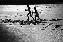 Mudland [Explored #369] (Cornelli2010) Tags: girls people blackandwhite bw playing france nature silhouette kids backlight sisters children frankreich mud provence schwestern mdchen gegenlicht camargue schlamm schwarzweis canonef70200mm14l canoneos5dmarkiii