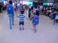 Hand in hand in hand (Roving I) Tags: children mothers siblings holdinghands backpacks ila travel brothersandsisters airports aviation saigon hcmc hochiminhcity vietnam