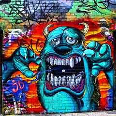Monsters Inc 1 (codedtestament777) Tags: citysights5 graffiti art beautiful love life design surreal text bright sign painting writing nature crazy weird fabulous environment cartoon animation outdoor street photo border photoborder illustration collection portrait face expression character