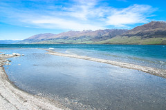 Lake Wanaka in Summer (danliecheng) Tags: newzealand southisland wanaka beach blue bottom clouds curve green lake landscape mountains pebbles sky spring summer transparent travel visit water waves wind