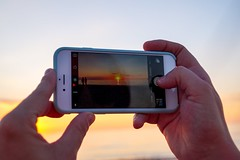 Sunset shoot. (christiannass) Tags: sunset idyllic germany warnemnde beach silhouette sun summer photographing mobilephone smartphone photographythemes holding technology portableinformationdevice usingphone water iphone leisureactivity person sonyslta58 selectivefocus balticsea seascape horizonoverwater