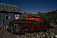 time traveler. eldorado canyon, nv. 2016. (eyetwist) Tags: eyetwistkevinballuff eyetwist night chrysler traveler sedan rusty techatticupmine eldoradocanyon nelson nevada abandoned ruins dark longexposure long exposure fullmoon desert nikon d7000 nikkor capturenx2 1024mmf3545g npy nocturne highdesert americana americantypology american typology dead desolate lonely derelict decay nv wideangle 1024mm shadow mojavedesert ruin lightpainting old vintage rust southwest startrails star trails techatticup mine typography ghosttown touristtrap coloradoriver grille hood patina chrome carmageddon red 1948 car auto chevron sign round corrugated tin timetravel timemachine supreme gasoline