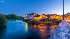 The Old Mill (Ray Moloney Photography) Tags: ifttt 500px river long exposure water night bridge light architecture travel reflection street lights building waterfall grey heron blue hour mill limerick ireland city streaks road cars wall pole guinness sign balcony reflections windows buidings