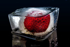 Ice Berry (part2) (nicoheinrich86) Tags: eis eiswrfel icecube ice strawberry erdbeere rot black white weis schwarz schrfentiefe dof details dunkel dark sony hx400v 2016 closeup contrast macro makro spiegelung reflection reflektion nah nass wet nikcollection nico