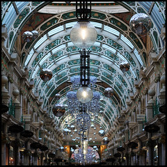 tinselled up (foto.phrend) Tags: christmas xmas shopping square yorkshire arcade leeds tinsel shops globes 500d