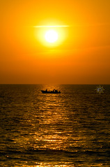 The arms of the Sun, Folding. (Oliyan | ) Tags: life sunset india reflection beach beauty landscape boat nikon goa content journey lone serene tamron incredible beachview nikond5100