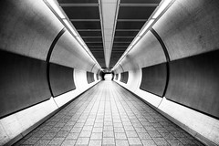 Space Station (Daniel Borg) Tags: city light england blackandwhite bw white black london abandoned lines architecture buildings underground lights vanishingpoint unitedkingdom pov empty tube wideangle tunnel trainstation tubestation londonunderground highkey kingscross canon1022 danielborg londontrainstation canon550d cityandarchitecture