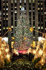 Merry Christmas (Gary Burke.) Tags: christmas xmas nyc newyorkcity winter decorations holiday ny newyork tree angel night canon eos rebel lights december manhattan decoration rockefellercenter landmark noel icon christmastree midtown angels gothamist dslr norwayspruce swarovskistar garyburke klingon65 t1i canoneosrebelt1i