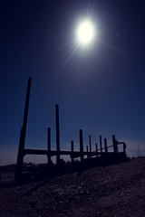 Morston Quay sentinels (Nick Caro - Photography) Tags: nightphotography blue winter moon silhouette night landscape harbor dock harbour nt jetty nick norfolk caro poles nationaltrust 2012 sentinels morston northnorfolk morstonquay wwwnickcarophotographycouk