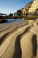 Sands of Lagos [Explored, best position #135] (Michael Baynes and Jenny Crow Photography) Tags: ocean travel vacation cliff holiday reflection beach portugal water lines rock canon relax eos sand europe waves lagos line explore algarve 50d explored challengeyouwinner thechallengegame