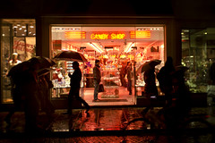 Emmenez-moi au Candy Shop // Lead me to the Candy Shop (Alexander JE Bradley) Tags: street pink light reflection wet rain shop night umbrella french photography store nikon neon artist candy belgium bright streetphotography lolly sidewalk westvlaanderen sweets bruges footpath lollypop lollie westflanders photographe candyshop nikor 2470mmf28 flemishregion d7000 alexanderbradley alexanderjebradley magasondebonbons rã©gionflamande