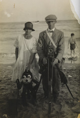 Beach photograph of a photographer, woman and Felix the Cat puppet (National Media Museum) Tags: 1920s sea beach monochrome seaside sand photographer puppet bowtie 20thcentury 1900s flatcap twenties felixthecat interwar