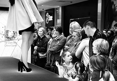 Fashionation (Andy WXx2009) Tags: street city girls people blackandwhite sexy men monochrome beauty mall shopping children women highheels legs audience candid stage femme crowd models streetphotography style indoors miniskirt catwalk mygearandme