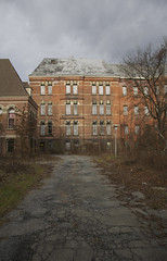 (Caitlin H. Faw) Tags: road november trees light shadow usa ny newyork color building architecture clouds digital hospital river landscape insane nikon moody decay empty stormy poughkeepsie hydepark hudson asylum barren boarded psychiatric 2012 d90 hudsonriverstatehospital caitlinfaw poughkeepsiehydepark