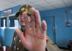 Picture Forbidden At Joint Security Area, Dmz, Panmunjom, North Korea (Eric Lafforgue) Tags: blue people color colour men horizontal architecture asian soldier army photography war asia day hand military authority border helmet security korea forbidden unitednations asie southkorea coree dmz oneperson armedforces northkorea onepeople humaninterest jsa dprk coreadelnorte colorimage lookingatcamera panmunjeom northkorean onlymen jointsecurityarea nordkorea onemanonly 1people democraticpeoplesrepublicofkorea img5459  armysoldier   coreadelnord koreandemilitarizedzone  unrecognizableperson  insidenorthkorea  rpdc soldierarmy  coreiadonorte