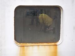 Mustard Station A (Feldore) Tags: yellow shirt reflection window ferry strangford northern ireland irish street candid seepage rusty rust surreal porthole feldore mchugh em1 olympus 1240mm