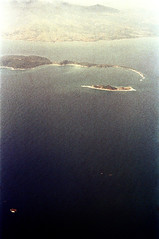 33-598 (ndpa / s. lundeen, archivist) Tags: nick dewolf nickdewolf 33 reel33 color photographbynickdewolf 1970s 1972 fall film 35mm winter 1973 aerial fromtheair fromtheairplanewindow unidentified water ocean sea island islands mountain mountains