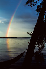 Nagagami Rainbow Silhouette (matthewkaz) Tags: rainbow nagagami nagagamilake lake water reflection reflections weather sky clouds tree hammock silhouette fishing fishcamp expeditionsnorth ontario canada 2016