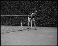 tennis warmup (Radoslaw Pujan) Tags: tennis court rocket woman photoshoot game pentax 6x7 film analog ilford hp5 heels sport