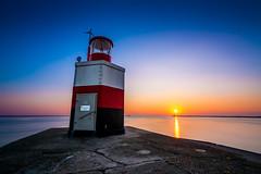 Lighthouse (jack.swinkels) Tags: lighthouse sunset sea ocean pier colors colours sun evening sky beautiful watchtower tower netherlands holland ijmuiden longexposure long exposure neutral density mar beach