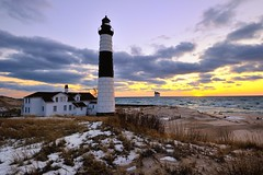 Winter Sunset Big Sable point Lighthouse Ludington State Park (Michigan Nut) Tags: winter sunset sky usa snow building beach clouds landscape waves scenic landmark lakemichigan fr johnmccormick bigsablepointlighthouse michigannutphotography