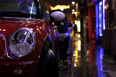 Mini Street (seegarysphotos) Tags: street blue shadow wet car yellow reflections manchester shiny neon pavement bubbles mini headlights chrome rainy nightime neonlights whell tyre afterdark canon450d seegarysphotos