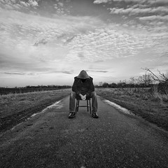 I'm not living, I'm just killing time (martinfowlie) Tags: road sky blackandwhite man clouds scary chair jacket fields hood radiohead fens cambridgeshire truelovewaits lmort