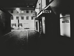 Bates Motel (Yves Roy) Tags: street city shadow urban blackandwhite bw black contrast dark austria blackwhite feldkirch interestingness interesting raw moody darkness noiretblanc 28mm snap fav20 gloom fav30 yr enigmatic fav10 ricohgrd grdiii bureboke yvesroy yrphotography