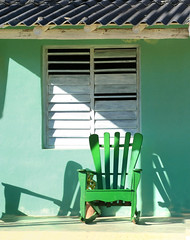 Front row seat.. (areyarey) Tags: wood old travel light sun house green heritage history home comfortable vintage relax wooden chair furniture antique seat country cuba style peaceful front retro patio deck rocker porch sit shutter rest rocking rockingchair relaxation vinales areyarey