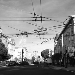 Divisadero St. (catlucia) Tags: iphone4s flickriosapp:filter=nofilter uploaded:by=flickrmobile iphoneography sanfrancisco street iphone sfist munielectricbuswires divisaderostreet citystreet urban