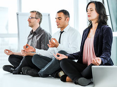 Successful businesspeople meditating in the office. (amandaholst1) Tags: people male men horizontal yoga businessman work table relax togetherness concentration office team women sitting adult desk contemporary laptop diversity meeting business indoors meditating workplace conventioncenter meditation manager ethnic job groupofpeople partnership boardroom variation ethnicity closedeyes caucasian businesspeople wellbeing officeworker occupation businesswoman lotusposition zenlike exercising threepeople healthylifestyle serenepeople hispanicethnicity professionaloccupation multiethnicgroup emotionalstress