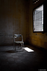 Interrogation (davidkoiter) Tags: school david window bar canon eos chair cambodia security prison 7d april lone l bleak series phnompenh f4 1740 2012 barred s21 khmerrouge polpot f4l koiter davidkoiter