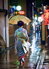 One Rainy Night in Kyoto (Explored) (Jake Jung) Tags: woman rain japan umbrella japanese alley kyoto sony streetphotography maiko geiko geisha  getty editorial  kimono gettyimages   flickrvision       apsc  feelingscolour nex7 japanoramamagazine sel50f18 e50mmf18oss gettyimagesjapan13q1 jakejung