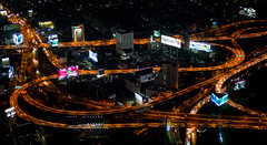 Bangkok traffic by night (Artrian) Tags: longexposure orange black streets night skyscraper thailand lumix 50mm asia exposure nightshot traffic bangkok f14 panasonic nightview topview 25mm dmcg3 leicadgsummilux25mmf14asph