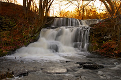 Below the Sunset (SunnyDazzled) Tags: november autumn trees light sunset shadow nature water landscape flow evening waterfall stream warm glow pennsylvania branches falls pa slowshutter shohola