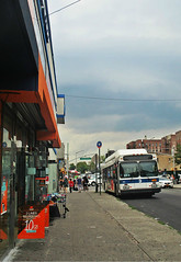 Bus stop on a lazy summer day (Robert S. Photography) Tags: busstop bus shops signs sky cloudy distance people construction summer street sidewalk kingshighway brooklyn nyc canon color poweshot elph160 iso160 july 2016