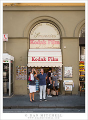 Kodak Moment (G Dan Mitchell) Tags: kodak film shop handcrafts store two people photographing florence firenze italy europe travel street photography souvenirs florentine