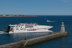 Condor Rapide (Ian Toms) Tags: hermtrident departing guernseyharbours guernsey condorferries guernseylife guernseystyle condorrapide harbour stpeterport