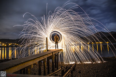 Boat Shed Jetty (Dan @ DG Images) Tags: wire wool spinning jetty boatshed port chalmers dunedin new zealand reflection broken ankle dgimages sky sunset round fire light blue glowstick