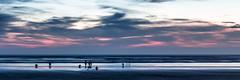 Kaimoana (grantg59@xtra.co.nz) Tags: kai moana kaimoana seafood shellfish toeheroa beach sunset dusk ocean sea clouds sky sand peolpe family