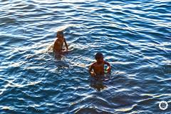 Children Swimming (AnaZamora) Tags: sea seascape swimming swim children fun happy photography nikon child philippines enjoy splash zamboangacity nikond3100
