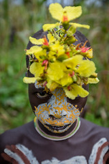 Surma tribe child with face painting and the flowers in the head (anthony pappone photography) Tags: africa travel flowers boy portrait baby white black art face yellow barn digital canon painting photography facepainting eyes paint artist foto faces image expression retrato african picture culture unesco clay portraiture tribes afrika omovalley ethiopia ritratto surma reportage photograher afrique bambino faccia eastafrica phototravel suri facepainted etiopia etnic whiteclay 非洲 etnico ethiopie etiope etnia argilla アフリカ loweromovalley etnica etnologia afryka childrentravel losniños etiopija portraitsofchildren 아프리카 etiopien kibish yellowclay africantribe африка etiopi eos5dmarkii tulgit अफ्रीका lowervalleyomo