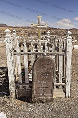 Goldfield, Nevada (Richard Ellis Photography) Tags: travel usa west abandoned tourism cemetery vertical rural america buildings gold town us cross desert empty nevada ghost bluesky nobody nopeople historic mining nv american mines western destination tombstones wildwest deserted eclectic arid tombs attraction goldfield gravemarker boomtown unoccupied