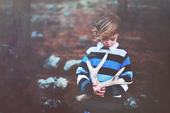 What I need is the dandelion in the spring. The bright yellow that means rebirth instead of destruction. The promise that life can go on, no matter how bad our losses. That it can be good again. (Adriana Gomez (Adriana Varela)) Tags: boy nature childhood forest walking holding child wind shed naturallight deer lookingdown antler 5yearold