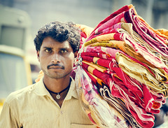 The Blanket Seller (Ragavendran / Rags) Tags: life portrait india look rural market candid streetphotography streetlife blanket stare colourful chennai seller stunned lookintomyeyes cwc rurallife indianlife koyambedu vintagetones coloursofindia chennaiweekendclickers ragavendran blanketseller